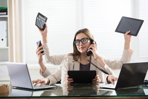 businesswoman six arms in office